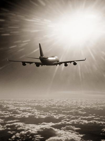 Airplane Flying Through Clouds-Peter Walton-Photographic Print