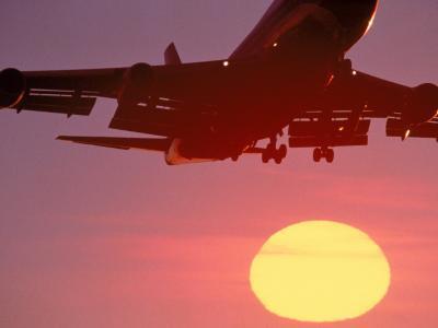 Airplane in Flight During Sunrise, Sunset-Mitch Diamond-Photographic Print
