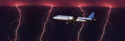 Airplane in Flight Through a Lighting and Rain Storm--Photographic Print