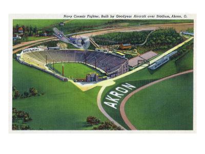Akron, Ohio - Goodyear Navy Corsair Fighter over Stadium-Lantern Press-Art Print