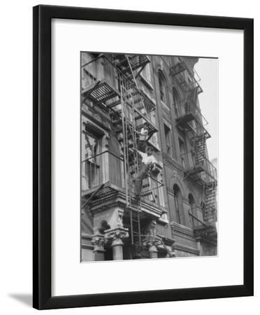 Puerto Rican Boys Climbing on Tenement Fire Escape