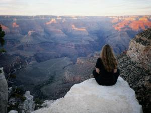 A Woman Looks out over the Spectacular Canyon Scenery by Al Petteway