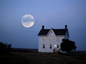 Moonrise over a Solitary Building by Al Petteway