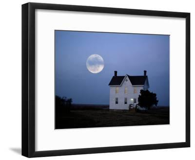 Moonrise over a Solitary Building