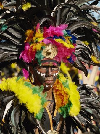 Man with Facial Decoration and Head-Dress with Feathers at Mardi Gras Carnival, Philippines