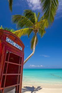 Caribbean, Antigua, Dickinson Bay, Dickinson Bay Beach, Red British Telephone Box by Alan Copson