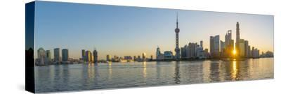 China, Shanghai, Pudong District, Skyline of the Financial District across Huangpu River at Sunrise