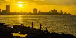Cuba, Havana, The Malecon, Man fishing by Alan Copson