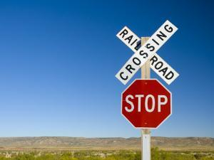 New Mexico, Route 66, Near Montoya, Railroad Crossing and Sign, USA by Alan Copson