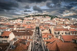 Portugal, Lisbon, Rooftop View of Baixa District with Sao Jorge Castle and Alfama District Beyond by Alan Copson