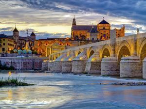 Roman Bridge Over Guadalquivir River and Mezquita, Cordoba, Cordoba Province, Andalucia, Spain by Alan Copson