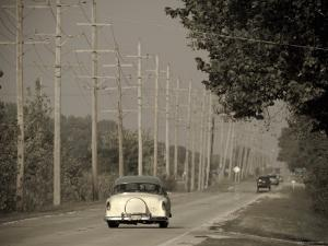 USA, Illinois, Route 66 at Godley, 1950's Car by Alan Copson