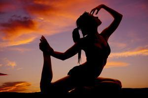 A Woman in a Dance or Yoga Pose in the Sunset by Alan Poulson Photography