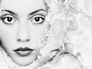 A Portrait of a Woman with White Floral Elements and Big Dark Eyes Looking into the Camera by Alaya Gadeh