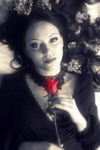 Portrait of a Woman with Dark Long Hair and a Red Rose in Her Hands in Monotone Colors by Alaya Gadeh