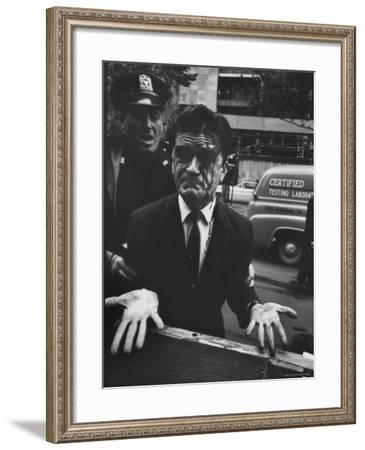 Albanian Demonstrator Hit as Police Broke Up Riot in Front of United Nations-Paul Schutzer-Framed Photographic Print