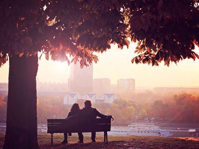 Romantic Couple on a Bench by the River