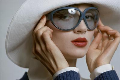 Model Wearing White Hat by Saint Laurent