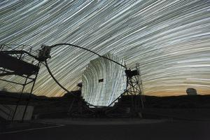 MAGIC Telescope And Star Trails by Alex Cherney