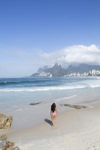 A 20-25 Year Old Young Brazilian Woman on Ipanema Beach with the Morro Dois Irmaos Hills by Alex Robinson