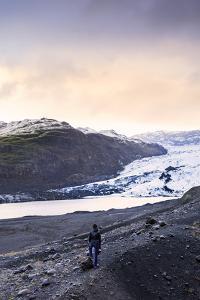 Hiker in front of the Vatnajokull glacier in Vatnajokull National Park in southeast Iceland, Polar  by Alex Robinson