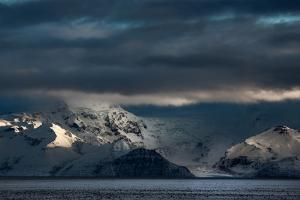 A Dramatic Sunrise over Mountains in Iceland by Alex Saberi
