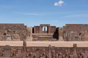 A Gate with a Sculpted Figure and the Temple of Kalasasaya by Alex Saberi