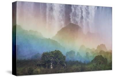 A Massive Rainbow Descends over Iguazu Falls