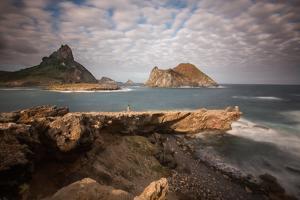 A Woman Stares Out at the Dramatic Landscape of Praia Do Sueste on Fernando De Noronha by Alex Saberi