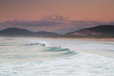Long Exposure of Surfers Enjoy the Wave on Praia Da Joaquina Beach