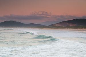 Long Exposure of Surfers Enjoy the Wave on Praia Da Joaquina Beach by Alex Saberi