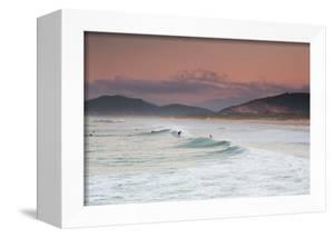Long Exposure of Surfers Enjoy the Wave on Praia Da Joaquina Beach by Alex Saberi