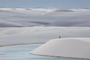 Man Walking in the Lencois Maranhenses Sand Dunes by Alex Saberi