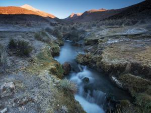 Water Runs from a Geyser Field in Sajama National Park at Sunrise by Alex Saberi