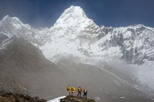 A Climbing Team Stand Looking Up at Ama Dablam in the Everest Region of Nepal by Alex Treadway
