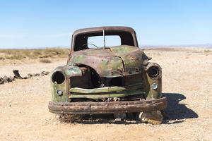 A Rusty Abandoned Car in the Desert Near Aus in Southern Namibia, Africa by Alex Treadway