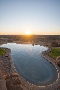A Swimming Pool on the Edge of the Desert at Canyon Lodge Near the Fish River Canyon, Namibia by Alex Treadway
