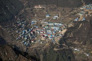 A view from Kongde looking down on Namche, the biggest village in Khumbu, the Everest region, Nepal by Alex Treadway
