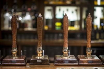 Beer Pumps in a Pub in Scotland by Alex Treadway
