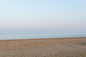 Pebbled Beach At Dungeness In Kent by Alex Treadway