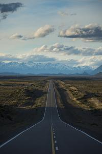 Route 40 in Patagonia with Distant Andean Peaks by Alex Treadway
