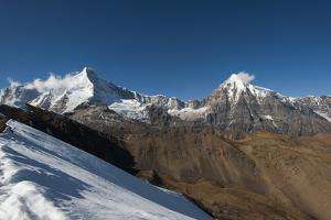 Snow on the Nyile La, a 4950m pass, and the peak of Jitchu Drake at 6714m in the distance, Bhutan, by Alex Treadway