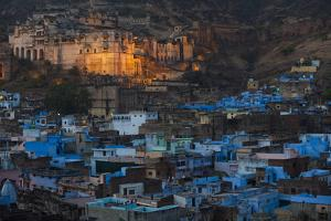 The blue buildings of Bundi lit up by a bright moon lit sky by Alex Treadway