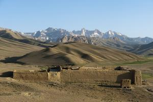 The Koh-e Baba mountains make an impressive backdrop in Bamiyan Province, Afghanistan, Asia by Alex Treadway
