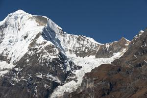 The looming face of Jomolhari, third highest mountain in Bhutan at 7326m, seen from Jangothang, Thi by Alex Treadway