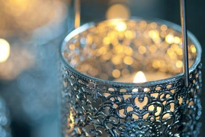 Candle in Metal Vessel