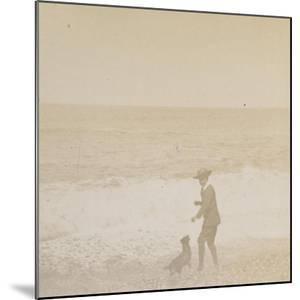 Jeune garçon et un chien face à la mer by Alexandre-Gustave Eiffel