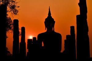Old Buddha Silhouette in Sukhothai Historical Park by Alexandre Moreau