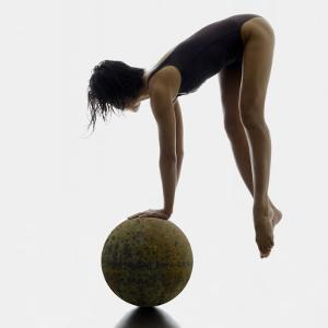 Woman Balancing on Globe by Alfonse Pagano