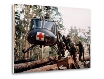 """American 4th Battalion, 173rd Airborne Brigade Soldiers Loading Wounded Onto a """"Huey"""" Helicopter"""